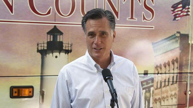In this June 19, 2012, file photo, Republican presidential candidate, former Massachusetts Gov. Mitt Romney speaks in Holland, Mich. A new Associated Press-GfK poll shows that Republican challenger Romney has moved into a virtually even position with the president after three months of declining job creation that have left the public increasingly glum. Fewer Americans believe the economy is getting better and a majority disapproves of how President Barack Obama is handling it. Only 3 out of 10 adults say the country is headed in the right direction. (AP Photo/Evan Vucci)