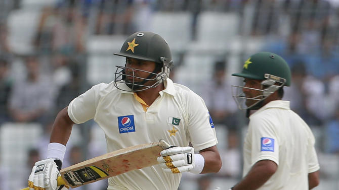 Pakistan's Azhar Ali, left, and Asad Shafiq run between the wickets during the second day of the second test cricket match against Bangladesh in Dhaka, Bangladesh, Thursday, May 7, 2015. (AP Photo/ A.M. Ahad)