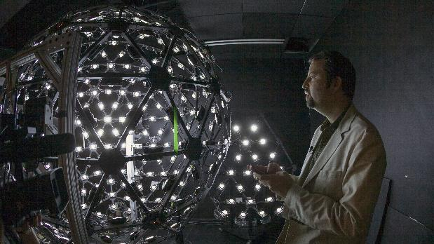 "In this photo taken Tuesday, Jan. 29, 2013, University of Southern California Institute for Creative Technologies, associate director for graphics research, Paul Debevec, explains the Lighting Stage X, a LED-filled sphere used to help create realistic virtual characters at the Graphics Lab in Playa Vista area of Los Angeles. The ""Virtual Survivor Visualization,"" a collaboration with the Shoah Foundation used the Lighting Stage X to digitize aging Holocaust survivors to create three-dimensional holograms that would not only be able to tell their stories to future generations but to engage in dialogue with them. (AP Photo/Damian Dovarganes)"