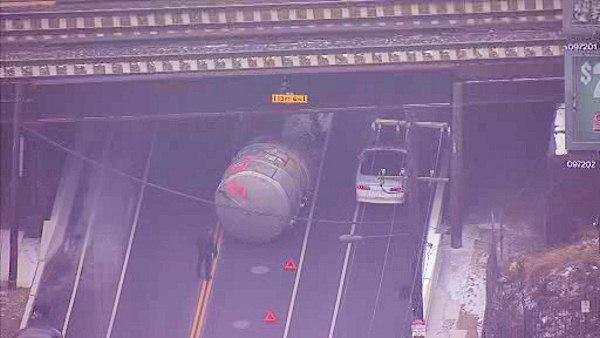 Container on truck strikes overpass in Tacony