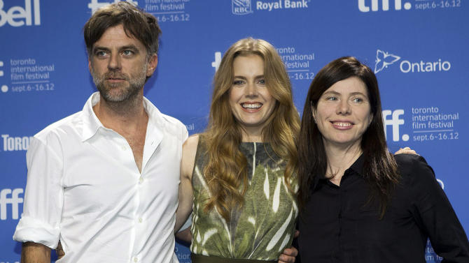 """FILE - In this Sept. 8, 2012 file photo, director Paul Thomas Anderson, left, poses with actress Amy Adams, center, and producer JoAnne Seller at a photo call before a press conference for their new movie """"The Master"""" at the 2012 Toronto International Film Festival in Toronto. On Sunday, Dec. 9, 2012, the Los Angeles Film Critics Association announced their picks for movies of 2012.  The French old-age drama """"Amour"""" was chosen as the year's best film.  The 1950s cult drama """"The Master"""" earned three awards: best director for Paul Thomas Anderson, best actor for Joaquin Phoenix and supporting actress for Amy Adams.  """"The Master"""" also was chosen as best-picture runner-up.  """"Amour"""" star Emmanuelle Riva shared the best-actress honor in a tie with Jennifer Lawrence for the lost-soul romance """"Silver Linings Playbook."""" Newcomer Dwight Henry was chosen as supporting actor for the low-budget critical darling """"Beasts of the Southern Wild.""""  (AP Photo/The Canadian Press, Michelle Siu, File)"""