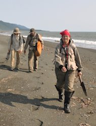 "Scientists walk along the shore in their protective bug suits, called ""encefalitka"" in Russian because they were designed for areas where the bugs carry encephalitis. Fortunately, said Joanne Bourgeois, the breezy shore helps keep bugs away and"