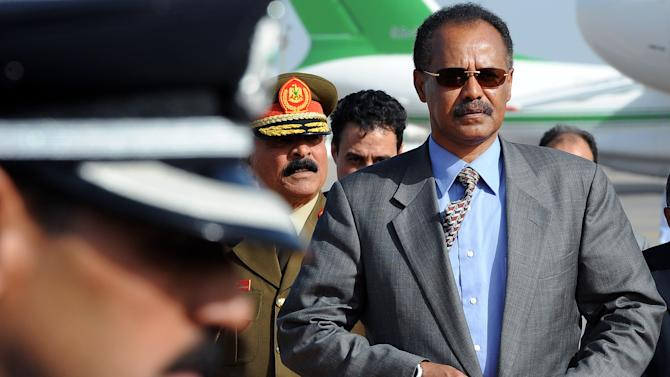 FILE - In this Sunday, Nov. 28, 2010 file photo, Eritrea's President Isaias Afworki arrives for an African Union summit at Mitiga Airport in Tripoli, Libya. More than 100 dissident soldiers stormed the Ministry of Information in the small East African nation of Eritrea on Monday, Jan. 21, 2013 and read a statement on state TV saying the country's 1997 constitution would be put into force, two Eritrea experts said. (AP Photo/Geert Vanden Wijngaert, File)