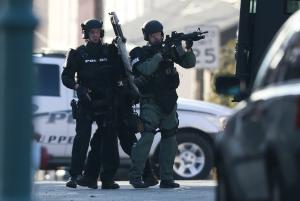 Police gather near a home, Monday, Dec. 15, 2014, in …
