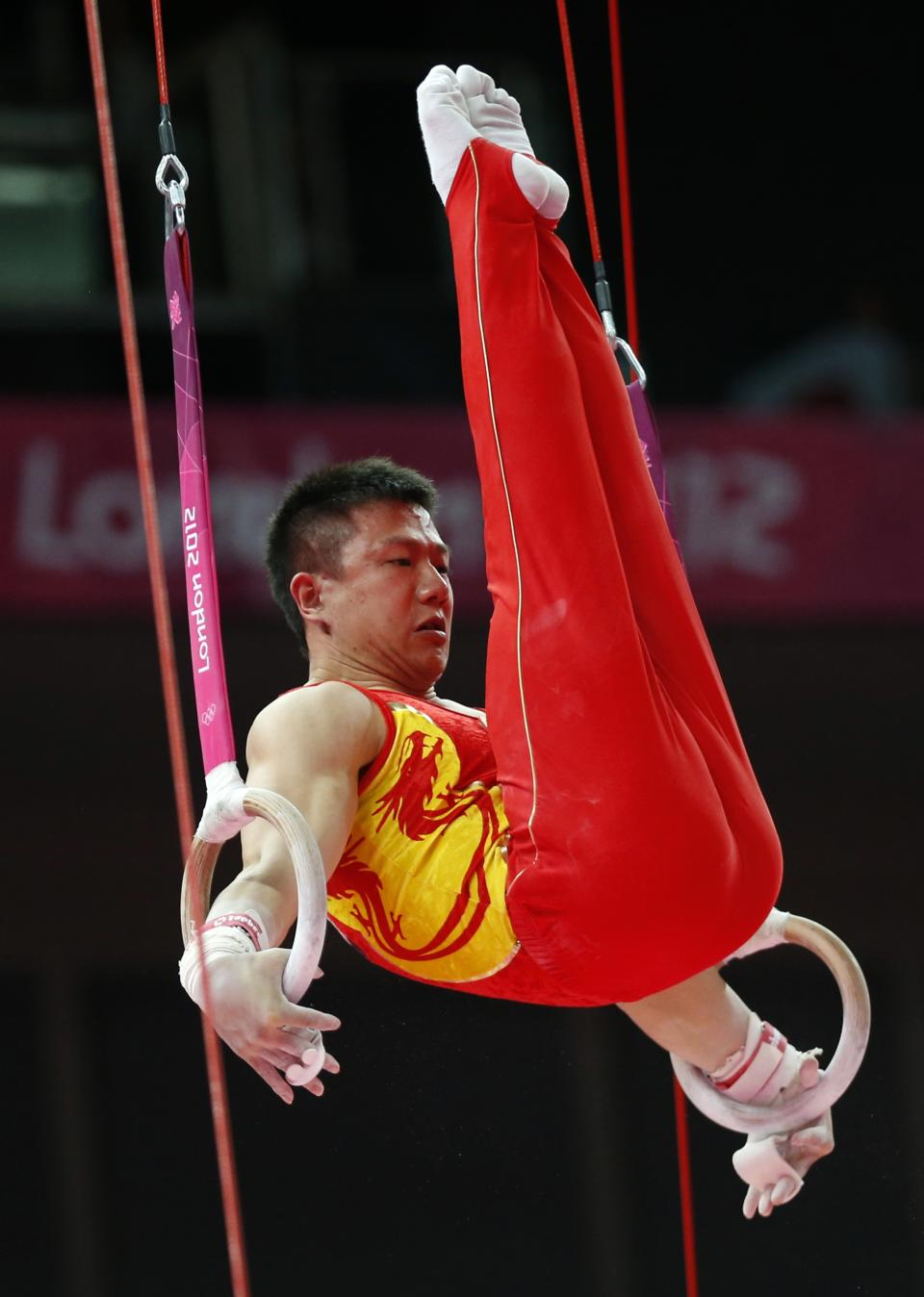 Chinese gymnast Chen Yibing performs on the rings during the Artistic Gymnastic men's team final at the 2012 Summer Olympics, Monday, July 30, 2012, in London. (AP Photo/Matt Dunham)
