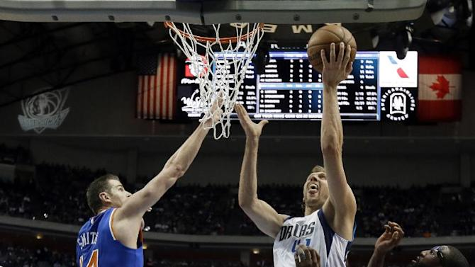 New York Knicks center Jason Smith (14) and forward Amare Stoudemire, right, defend as Dallas Mavericks' Dirk Nowitzki (41), of Germany, goes up to make a basket in the first half of an NBA basketball game, Wednesday, Nov. 26, 2014, in Dallas. (AP Photo/Tony Gutierrez)