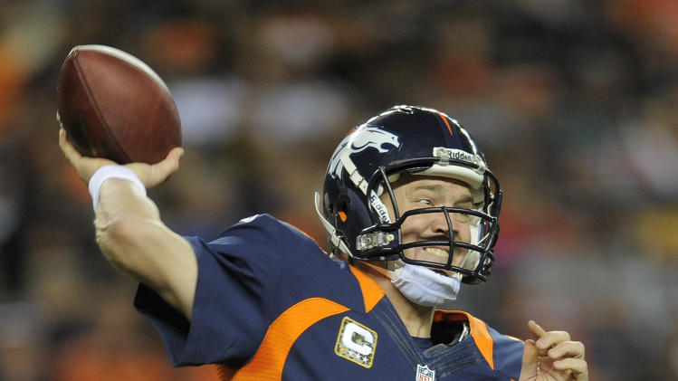 Denver Broncos quarterback Peyton Manning (18) throws against the San Diego Chargers in the fourth quarter of an NFL football game, Sunday, Nov. 18, 2012, in Denver. The Broncos won 30-23. (AP Photo/Jack Dempsey)