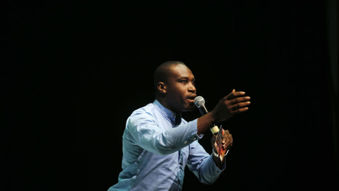 A comedian called Oniru16 performs on stage during a special Boxing Day edition of the comedy show Stand Up Nigeria in Lagos