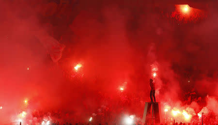 Fans of Egypt's Al Ahly light flares during their African Confederations Cup final soccer match against Ivory Coast's Sewe Sport at Cairo stadium