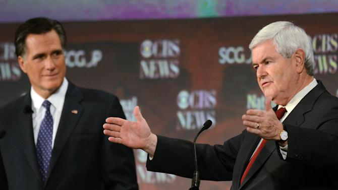 Republican presidential candidates Newt Gingrich,  left, speaks as Mitt Romney,  listens during the CBS News/National Journal foreign policy debate at the Benjamin Johnson Arena, Saturday, Nov. 12, 2011 in Spartanburg, S.C. (AP Photo/Richard Shiro)
