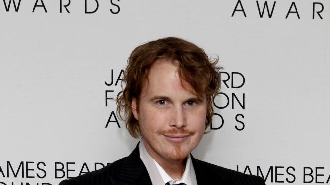 """In this May 7, 2012 file photo, chef Grant Achatz poses after his """"Who's Who of Food & Beverage in America"""" induction during the James Beard Foundation Awards, in New York. At Alinea, the Chicago temple of theatrical molecular gastronomy, chef Grant Achatz has contemplated having servers choreograph their motions to the music of a live cellist. (AP Photo/Jason DeCrow, File)"""