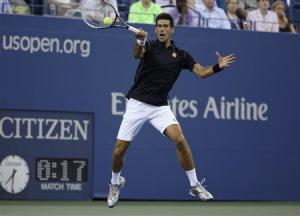 Djokovic of Serbia returns a forehand to Sousa of Portugal at the U.S. Open tennis championships in New York