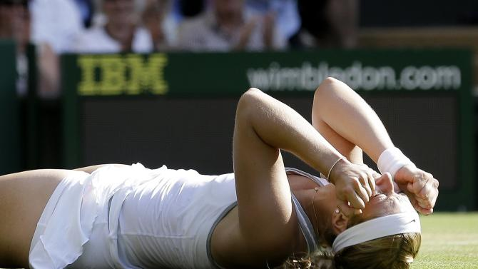 Sabine Lisicki of Germany reacts after defeating Agnieszka Radwanska of Poland in a Women's singles semifinal match at the All England Lawn Tennis Championships in Wimbledon, London, Thursday, July 4, 2013. (AP Photo/Anja Niedringhaus)