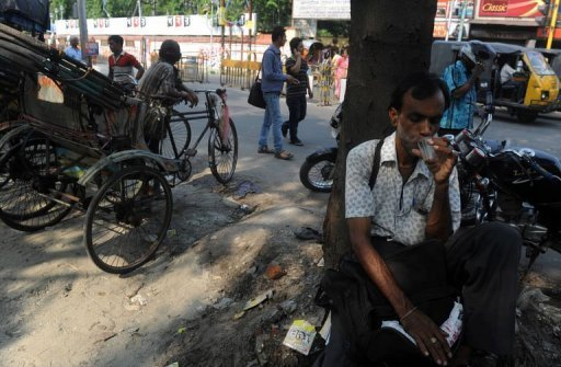 An Indian drinks tea at roadside shop in Siliguri