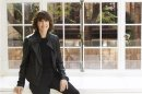 File photo of Nora Ephron posing for a portrait in her home in New York