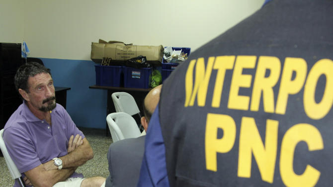 In this image released by Guatemala's National Police on Wednesday Dec. 5, 2012, software company founder John McAfee sits after being arrested for entering the country illegally Wednesday Dec. 5, 2012 in Guatemala City. The anti-virus guru was detained at a hotel in an upscale Guatemala City neighborhood with the help of Interpol agents hours after he said he would seek asylum in the Central American country. (AP Photo/Guatemala's National Police)
