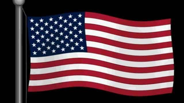 English teacher stomps on American flag