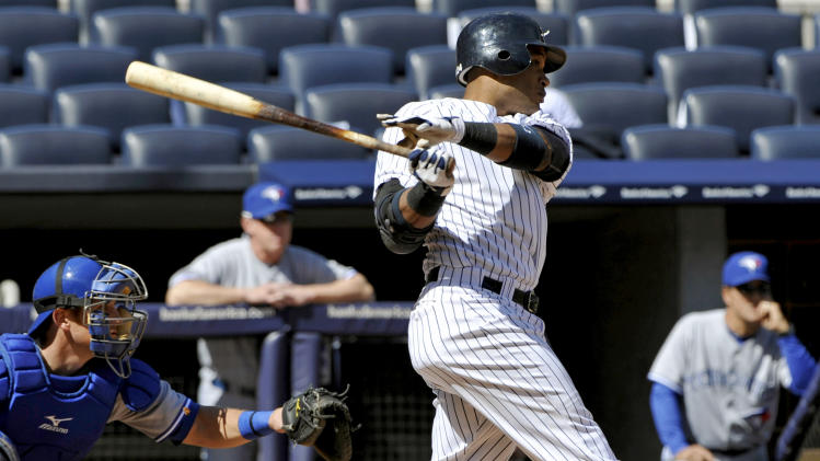 New York Yankees' Robinson Cano hits an RBI double during the first inning of the first baseball game of a doubleheader against the Toronto Blue Jays, Wednesday, Sept. 19, 2012, at Yankee Stadium in New York. The Yankees won 4-2. (AP Photo/Bill Kostroun)