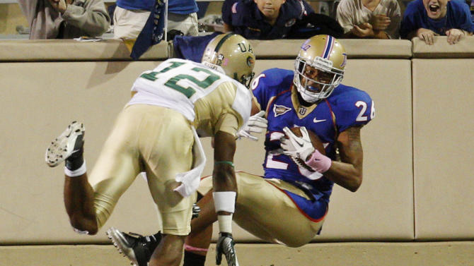 Tulsa defensive back Dexter McCoil, right, comes down with an interception in the end zone in front of UAB wide receiver Nick Adams, left, during the fourth quarter of an NCAA college football game in Tulsa, Okla., Saturday, Oct. 15, 2011. Tulsa won 37-20. (AP Photo/Sue Ogrocki)