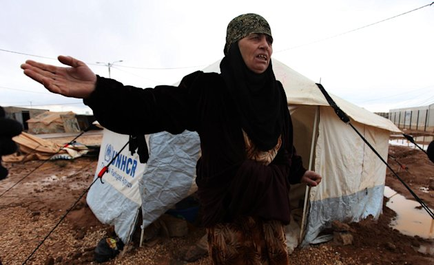 A Syrian refugee woman complains about limited winter resources, at Zaatari Syrian refugee camp, near the Syrian border in Mafraq, Jordan, Tuesday, Jan. 8, 2013. Syrian refugees in a Jordanian camp at