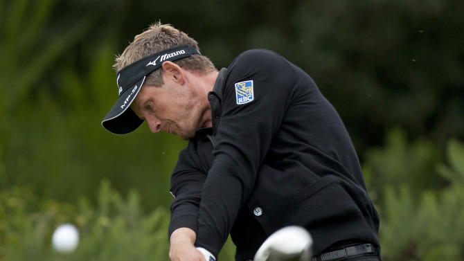 England's Luke Donald hits a drive off the 2nd tee during a practice round at the Royal Lytham & St Annes golf club before the forthcoming British Open Golf tournament, Lytham St Annes, England, Monday July 16, 2012. (AP Photo/Jon Super)