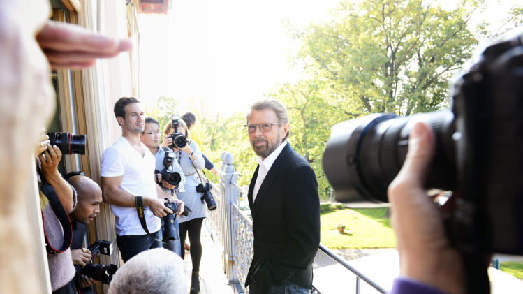 "Former ABBA band member Bjoern Ulvaeus, centre, arrives for a news conference, at the ABBA museum construction site in Stockholm., Sweden, Wednesday Oct. 3, 2012. A traveling ABBA exhibit is to get a permanent home in a new museum dedicated mostly to the Swedish quartet that has sold nearly 400 million records since its heyday in the 1970s. Former band member Bjoern Ulvaeus said Wednesday that ""ABBA The Museum"" will be part of a Swedish music hall of fame to be inaugurated in Stockholm next spring. (AP Photo/Henrik Montgomery) SWEDEN OUT"