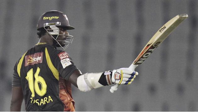 SRH batsman Thisara Perera celebrates in half century during the CLT20 match between Trinidad & Tobago and Sunrisers Hyderabad at Mohali, Chandigarh on Sept. 24, 2013. (Photo: IANS)