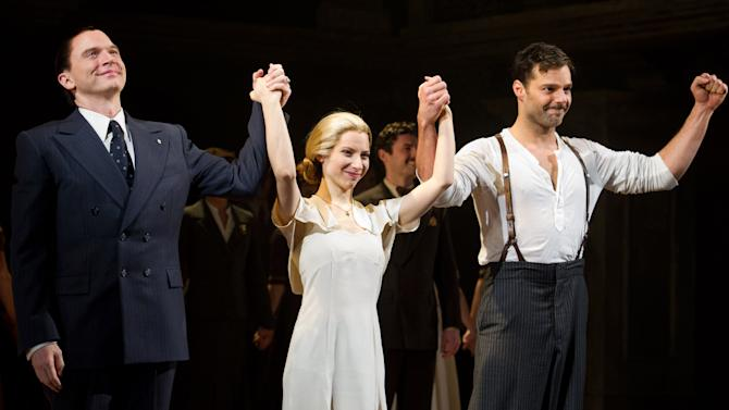 """FILE - In this March 12, 2012 file photo, from left, Michael Cerveris, Elena Roger and Ricky Martin appear at the curtain call after their first performance in the new Broadway production of """"Evita"""" in New York. Martin commands the stage with an air of confidence, yet the Latin superstar admitted Thursday, April 5, to being self-conscious at times. (AP Photo/Charles Sykes, File)"""