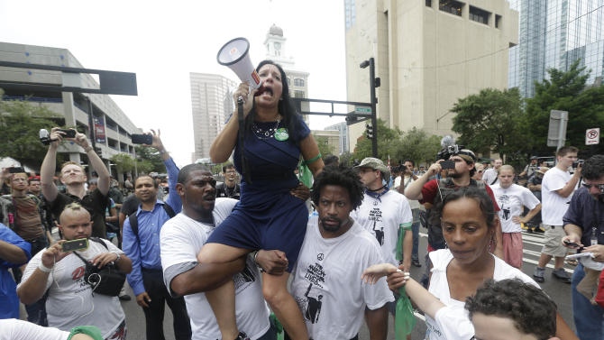 Demonstrators march through the streets of Tampa, Fla., to protest the Republican National Convention on Monday, Aug. 27, 2012. (AP Photo/Patrick Semansky)