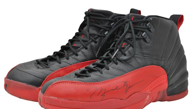 This undated image provided by Grey Flannel Auctions shows Michael Jordan's shoes from the famous flu game of the 1997 NBA Finals. The Nike shoes sold on an online auction Thursday Dec. 12, 2013, for $104,765. The shoes were owned by a Utah Jazz ball boy, Preston Truman, who befriended Jordan when the Chicago Bulls visited Salt Lake City. Jordan was playing with what he thought was the flu, but still led the Bulls to a key victory in the NBA Finals