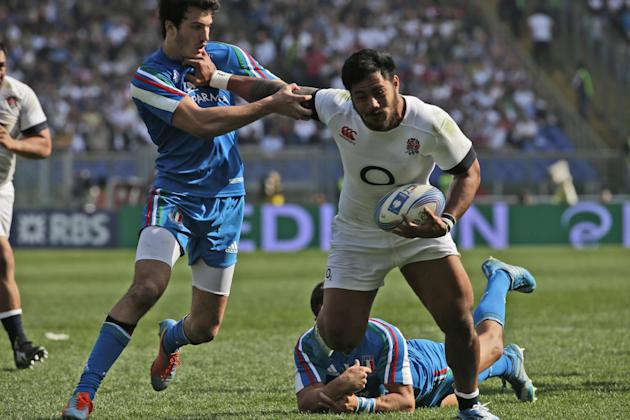 England's Manusamoa Tulagi, right, scores as Leonardo Sarto, left, tries to stop him during a Six Nations international rugby union match between Italy and England, in Rome, Saturday, March 15, 20