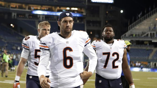 Chicago Bears quarterback Jay Cutler (6) and teammates Shea McClellin and Charles Leno (72) walk off the field after a preseason NFL football game, Friday, Aug. 22, 2014, in Seattle. The Seahawks won 34-6