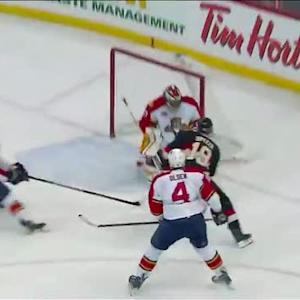 Jason Spezza dances around Olsen for goal