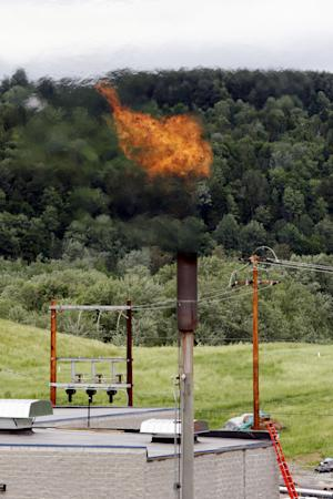 FILE - In this June 15, 2005 photo, methane gas burns off a stack near the  Washington Electric Cooperative power plant in Coventry, Vt. An international team of scientists say they've figured out how to slow global warming in the short run, prevent millions of deaths from dirty air and increase food production. And it will save more money than it will cost. They say the key is to reduce emissions of two other greenhouse gases instead of carbon dioxide. Those pollutants are methane and soot. Those powerful  gases are fast acting so reducing them would pay off quickly. Soot also is a big health problem, so cutting it would save lives. (AP Photo/Toby Talbot, File)
