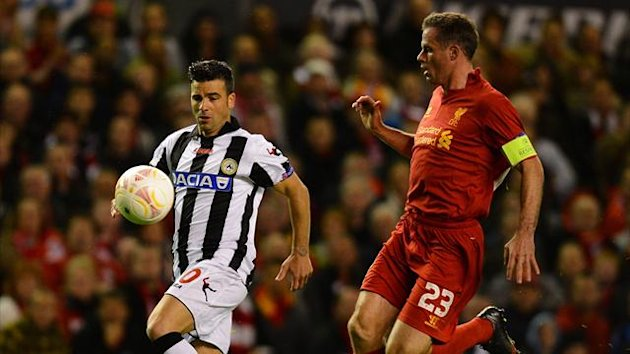 Udinese's Italian forward Antonio Di Natale (L) vies for the ball with Liverpool's English defender Jamie Carragher during the UEFA Europa League football match between Liverpool and Udinese (AFP)