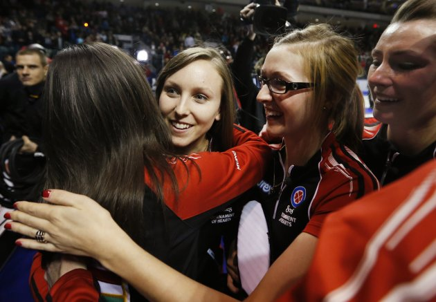 Ontario skip Homan celebrates with teammates after defeating Manitoba during their gold medal game at the Scotties Tournament of Hearts curling championship in Kingston