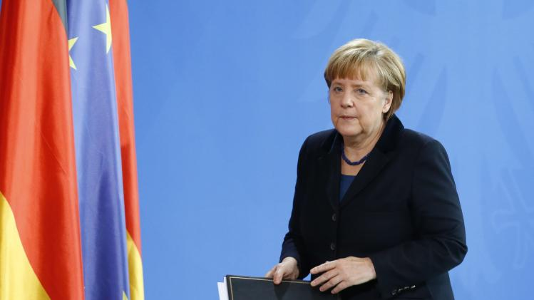 German Chancellor Merkel leaves after statement to media in Berlin