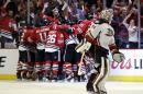 Anaheim Ducks goalie Frederik Andersen skates off the ice as Chicago Blackhawks celebrate an Antoine Vermette goal during the second overtime in Game 4 of the Western Conference finals of the NHL hockey Stanley Cup Playoffs, Saturday, May 23, 2015, in Chicago. Chicago won 5-4.(AP Photo/Nam Y. Huh)