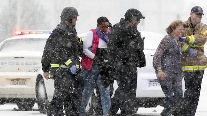 Two women are evacuated from a building where a shooter was suspected to be still holed up in Colorado Springs
