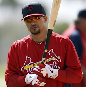 FILE - St. Louis Cardinals shortstop Rafael Furcal waits to take batting practice during spring training baseball, in this Feb. 19, 2013 file photo taken in Jupiter, Fla. The free-agent infielder and the Marlins agreed to terms on a contract, two people familiar with the situation said Thursday Dec. 5, 2013. Furcal, a three-time All-Star, sat out this season after undergoing elbow ligament-replacement surgery in March. (AP Photo/Julio Cortez, File)