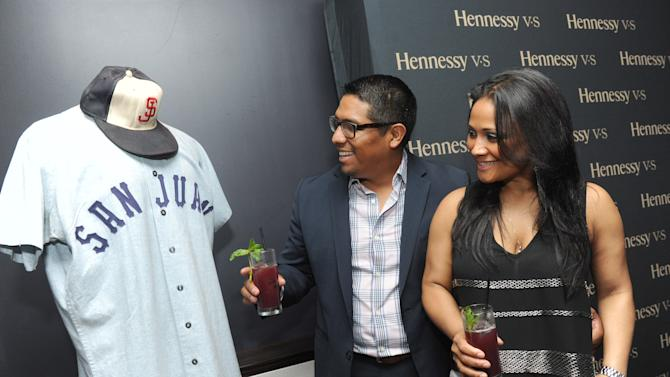 IMAGE DISTRIBUTED FOR HENNESSY V.S - Guests view the last jersey worn by Roberto Clemente, from the 1972 San Juan Senators, during a Hennessy V.S event to celebrate the history of Latinos in baseball at the Parlor in New York, Thursday, June 27, 2013. This event marked the first time Roberto Clemente memorabilia traveled outside of the Clemente Museum in Pittsburgh. (Photo by Diane Bondareff/Invision for Hennessy V.S/AP Images)