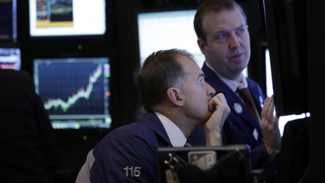 A pair of traders work in a booth on the floor of the New York Stock Exchange, Monday, Nov. 4, 2013. Stocks indexes rose slightly on Monday as investors looked ahead to Twitter's highly anticipated public offering later this week and the Labor Department's employment survey on Friday. (AP Photo/Richard Drew)