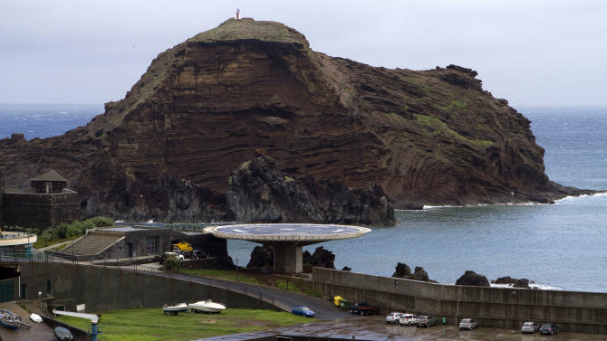 In this photo taken Oct. 30, 2012, a helipad stands next to the port in the fishing village of Porto Moniz, in the Portuguese island of Madeira. The helipad cost 670,000 euros and locals say no helicopter has ever landed there. The EU's aid policy for less well-off parts of the continent, meant to help bridge the wealth gap between rich areas of the bloc and poor, has done much to boost livelihoods. But the bonanza of easy money also bred political vanity projects, bridges to nowhere, lax oversight and widespread corruption, and wiser investments that might sustain long-term growth were often neglected. (AP Photo/Joana Sousa)