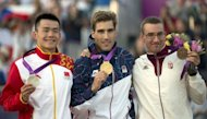 From L: China's Cao Zhongrong, Czech Republic's David Svoboda, and Hungary's Adam Marosi celebrate on the podium of the Modern Pentathlon during the 2012 London Olympics