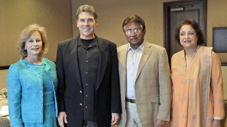 From left, Anita Perry stands next to her husband Texas Gov. Rick Perry, Former Pakistani President Pervez Musharraf and his wife, Saba Musharraf, as they post for photographs on Tuesday, July 12, 2011, in Austin, Texas.   Musharraf met with Perry to exchange ideas about improving the economy and discuss the strained relationship between the U.S. and Pakistani governments. Musharraf has been critical of the White House's recent suspension of $800 million in U.S. aid to the Pakistani military, saying the decreased aid will hurt his country and hinder its fight against terrorism.  (AP Photo/Michael Thomas)