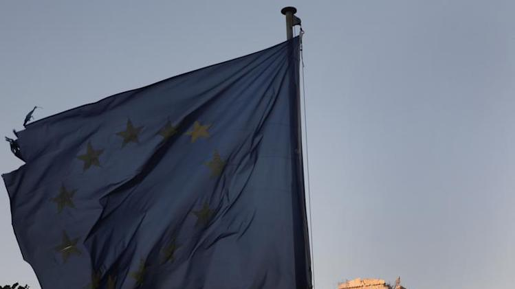 An European Union flag flutters in front of the Parthenon temple in Athens