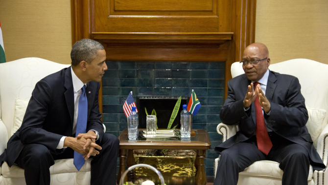 "U.S. President Barack Obama, left, talks with South African President Jacob Zuma at the Union Building on Saturday, June 29, 2013, in Pretoria, South Africa. The visit comes at a poignant time, with former South African president and anti-apartheid hero Nelson Mandela ailing in a Johannesburg hospital. The White House issued a statement Saturday that President Barack Obama plans to visit privately with relatives of former South African President Nelson Mandela, but doesn't intend to see the critically ill anti-apartheid activist he has called a ""personal hero."" (AP Photo/Evan Vucci)"
