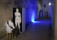 "A man sits in front of an installation that is part of a philosophy experiment in Corigliano d'Otranto. Philosophers believe that Italy's real problem was not the economic crisis but ""the crisis in the relationship between man and his surroundings"""
