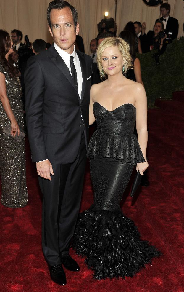 Will Arnett and Amy Poehler arrive at the Metropolitan Museum of Art Costume Institute gala benefit, celebrating Elsa Schiaparelli and Miuccia Prada, Monday, May 7, 2012 in New York. (AP Photo/Charles Sykes)