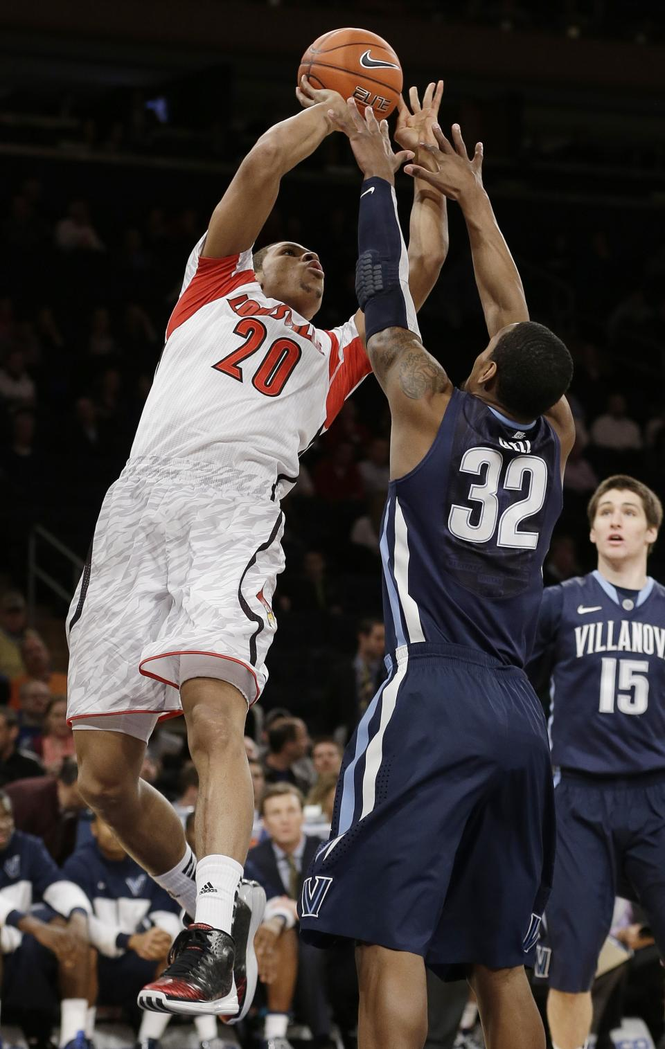 Louisville's Wayne Blackshear (20) shoots over Villanova's James Bell (32) during the first half of an NCAA college basketball game at the Big East Conference tournament, Thursday, March 14, 2013, in New York. (AP Photo/Frank Franklin II)
